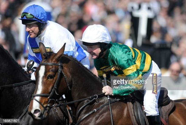 Retired jockeys Bob Champion and Jonjo O'Neill at Aintree racecourse on April 06 2013 in Liverpool England