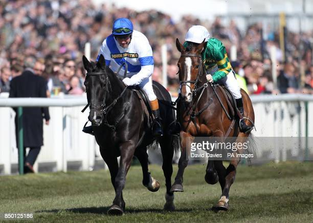 Retired jockeys Bob Champion and Jonjo O'Neill in action during The John Smith's Aintree Legends Charity Race during Grand National Day at Aintree...