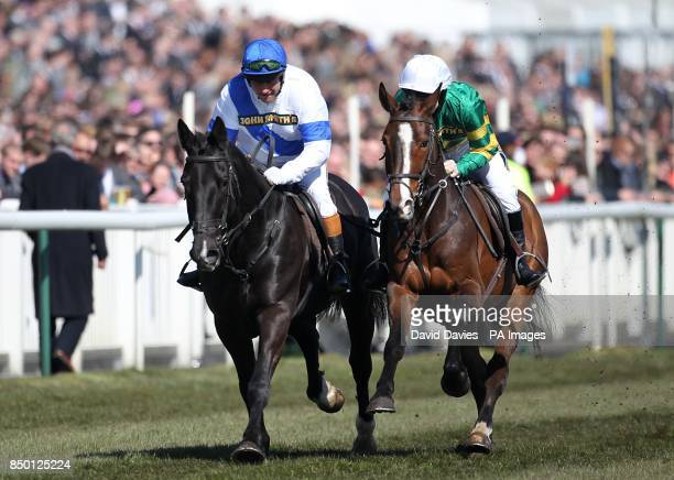 Retired jockeys Bob Champion and Jonjo O'Neill in action during The John Smith's Aintree Legends Charity Race during Grand National Day at the 2013...