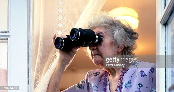 Retired lady snooping on neighbours