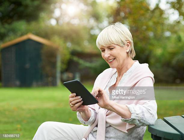 Retired lady using Kindle