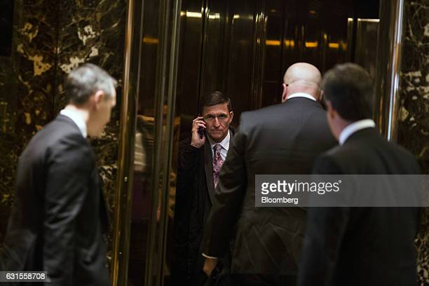 Retired Lieutenant General Michael Flynn White House national security adviserdesignate center stands in an elevator at Trump Tower in New York US on...