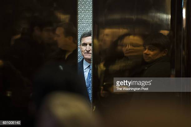 Retired Lt Gen Michael Flynn Presidentelect Donald Trump's pick for National Security Adviser boards an elevator at Trump Tower in New York NY on...