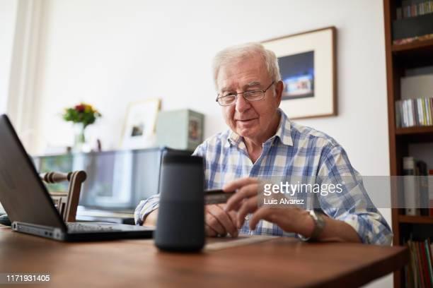Retired man doing online purchase