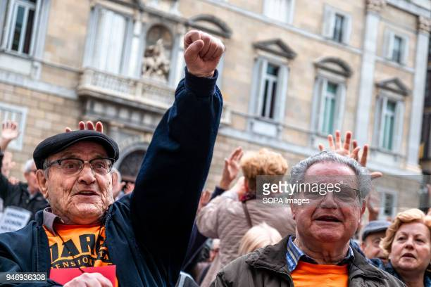 A retired man is seen raising his fist to claim fair pensions Hundreds of retirees and pensioners have demonstrated in the streets of Barcelona in...