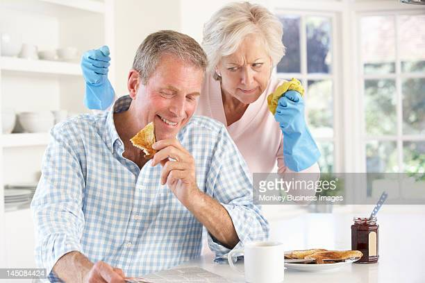 retired man not helping with housework - monkey eating paper stock pictures, royalty-free photos & images
