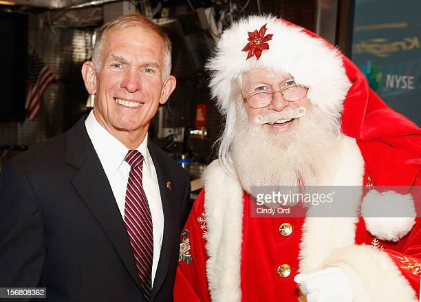 Retired Marine Lieutenant General Pete Osman President and CEO of the Marine Toys for Tots Foundation and Santa Claus visit the New York Stock...