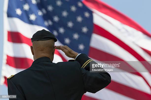 Retired Milton S Herring saluting US flag, Los Angeles National Cemetery Annual Memorial Event, California.