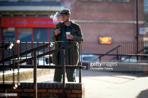 Retired miner Dennis Ager aged 73 drinks coffee in Workington town centre as a political think tank declared that politicians need to win the vote of...