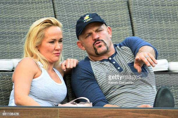 Retired mixed martial artist and former UFC Light Heavyweight Champion Chuck Liddell and his wife poker player Heidi Northcott attend the tennis...