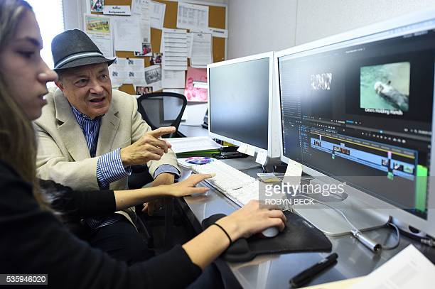 Retired motion picture industry attorney Bob Mirisch looks over video created by community members with media production assistant Kennedy Fontenot...
