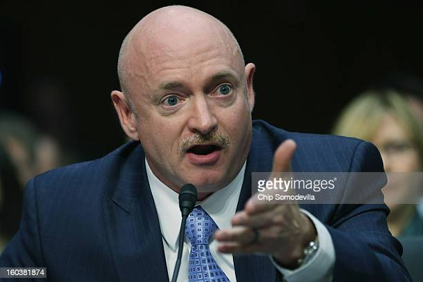 Retired NASA astronaut and Navy Capt. Mark Kelly testifies during a Senate Judiciary Committee hearing about gun control on Capitol Hill January 30,...