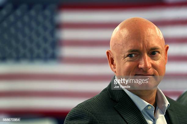 Retired NASA astronaut Mark Kelly waits to speak during a press conference where he joined his wife, former Rep. Gabrielle Giffords, and other...