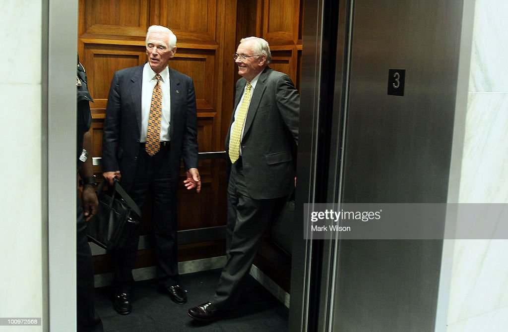 Retired NASA astronaut Neil Armstrong (R) commander of the Apollo 11 mission and the first man to walk on the moon, along with retired astronaut Capt. Eugene Cernan (L), ride in a elevator after leaving a hearing on Capitol Hill May 26, 2010 in Washington, DC. Armstong and Cernan testified before the House Science and Technology Committee on the future of U.S. human space flight.