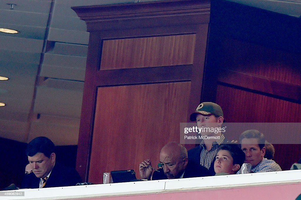 Retired Navy Seal Rob O'Neill (with hat) sits in the owners box as the Washington Redskins take on the Tampa Bay Buccaneers at FedExField on November 16, 2014 in Landover, Maryland.