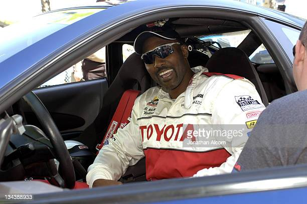 Retired NBA great Karl Malone gets ready to drive on Qualifying Day for 2005 Toyota Pro/Celebrity race in Long Beach California on April 8 2005