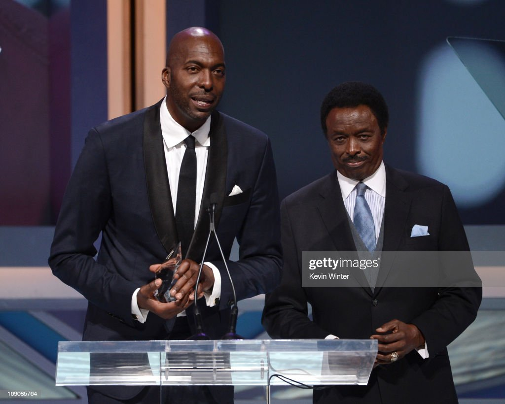 Retired NBA player and radio host John Salley and sportscaster Jim Hill speak onstage at the 28th Anniversary Sports Spectacular Gala at the Hyatt Regency Century Plaza on May 19, 2013 in Century City, California.