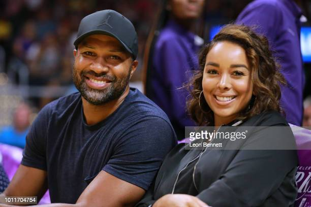 Retired NBA player Derek Fisher and Gloria Govan take in the Phoenix Mercury vs Los Angeles Sparks during a WNBA basketball game at Staples Center on...