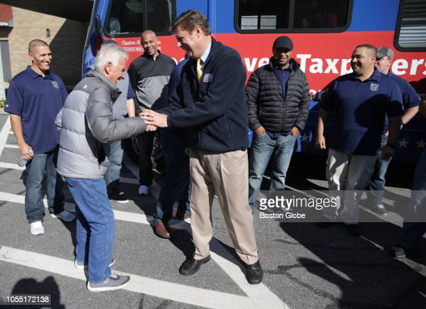 Retired New Bedford police officer Octavio Tacky Pragana left greets Republican US Senate candidate Geoff Diehl in Plymouth MA on Oct 25 2018 Diehl...