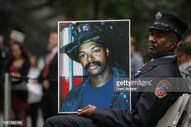 Retired New York City firefighter Bruce Stanley holds a portrait of his late friend Liam Smith Jr a New York City firefighter who died in the 9/11...