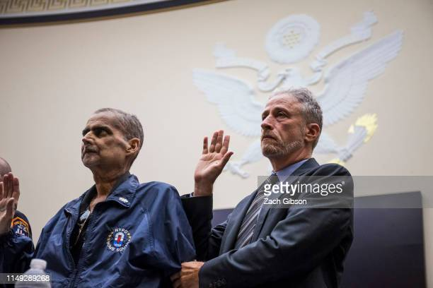 Retired New York Police Department detective and 9/11 responder Luis Alvarez left and Former Daily Show Host Jon Stewart right are sworn in before...