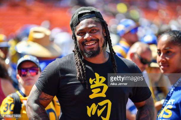 Retired NFL footballer Marshawn Lynch is all smiles before the preseason game between the Dallas Cowboys and the Los Angeles Rams at Aloha Stadium on...