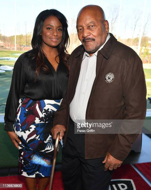 Retired NFL Player Jim Brown and his wife Monique Brown attend Jim Brown Legends of Football Golf Tournament at Topgolf Midtown on February 01, 2019...