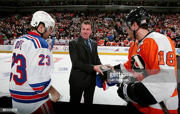 Retired NHL Linseman Pat Dapuzzo stands center during a jersey presentation with Mike Richards of the Philadelphia Flyers and Chris Drury of the New...
