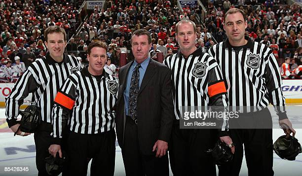 Retired NHL Linseman Pat Dapuzzo stands with Referees Kevin Pollock and Kelly Sutherland and Linesmen Steve Barton and Derek Amell after being...