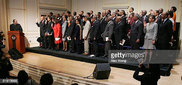 Retired North Carolina Supreme Court Chief Justice Henry Frye swears in members of the Congressional Black Caucus of the 109th Congress January 4...