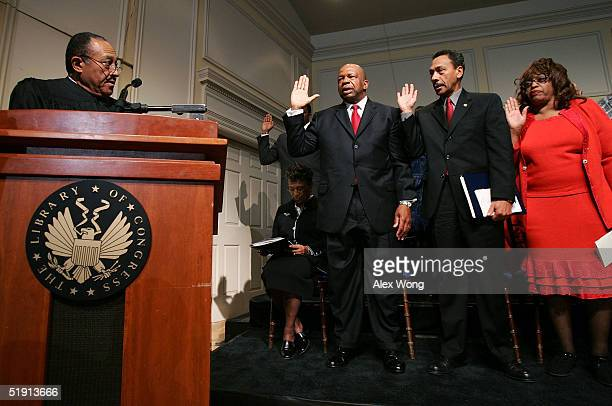 Retired North Carolina Supreme Court Chief Justice Henry Frye swears in members of the Congressional Black Caucus of the 109th Congress, outgoing...
