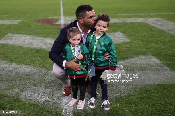 Retired NRL player Greg Inglis poses for a photo with his son Nate Alexander and daughter Quinnsy Bella before the round eight NRL match between the...