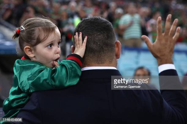 Retired NRL player Greg Inglis waves to the crowd with his daughter Quinnsy Bella before the round eight NRL match between the South Sydney Rabbitohs...
