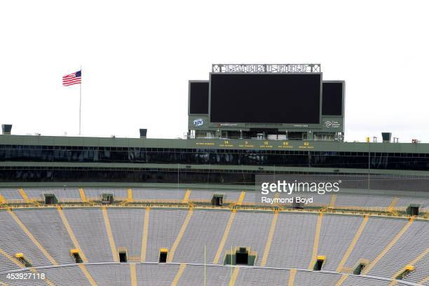 Retired numbers of former players are displayed at the North End of Lambeau Field home of the Green Bay Packers football team on August 16 2014 in...
