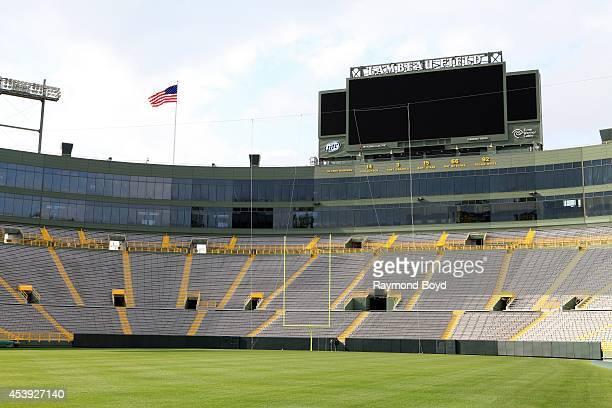 Retired numbers of former players are displayed at the North End of Lambeau Field, home of the Green Bay Packers football team on August 16, 2014 in...