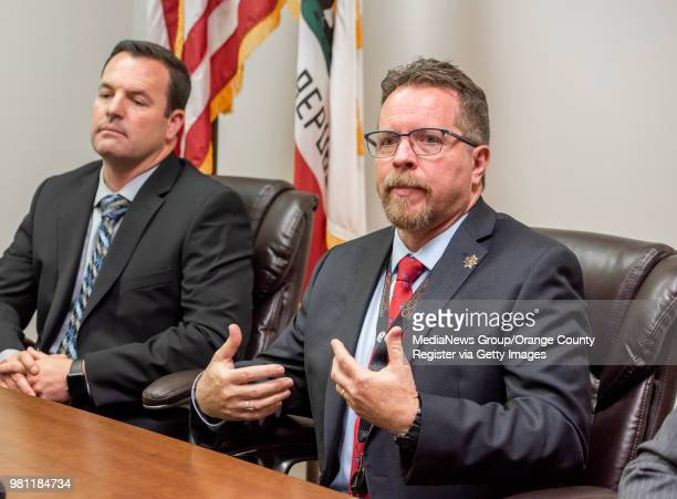 Retired Orange County Sheriff's homicide investigator Larry Pool right answers a reporters questions during a press conference at the Orange County...
