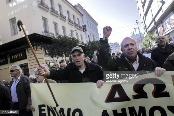 Retired people stage a demonstration against cutting their retirement salary within austerity measures imposed by the Greek government at Kotzia...