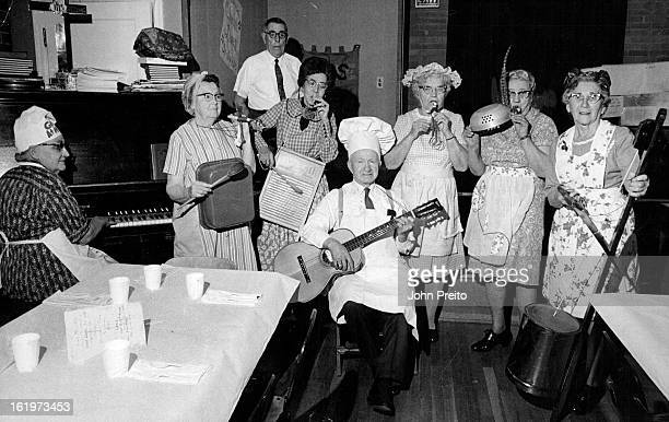 "Retired Persons Perform As A ""Culinary Band""; Members, from left, are Mrs. Daisy Blom, piano; Mrs. Genevieve Bailey, dish pan; Miss Thais Lampe,..."