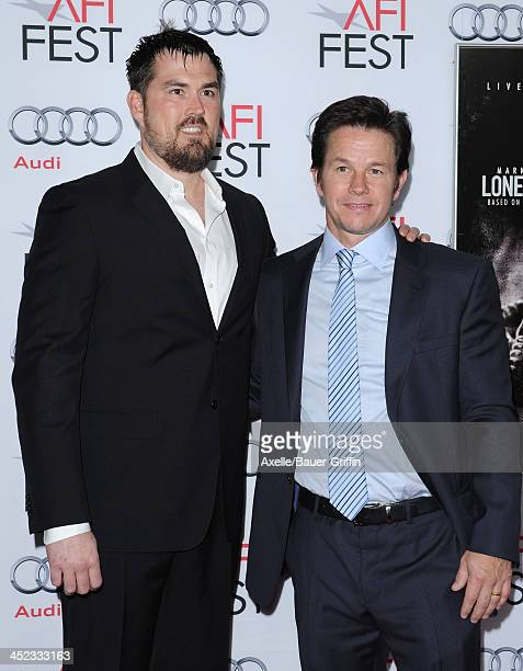 Retired petty officer 1st class Marcus Luttrell and actor Mark Wahlberg attend the screening of 'Lone Survivor' at AFI FEST 2013 at the TCL Chinese...