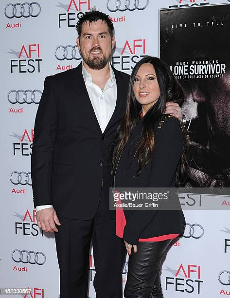 Retired petty officer 1st class Marcus Luttrell and wife Melanie Juneau attend the screening of 'Lone Survivor' at AFI FEST 2013 at the TCL Chinese...