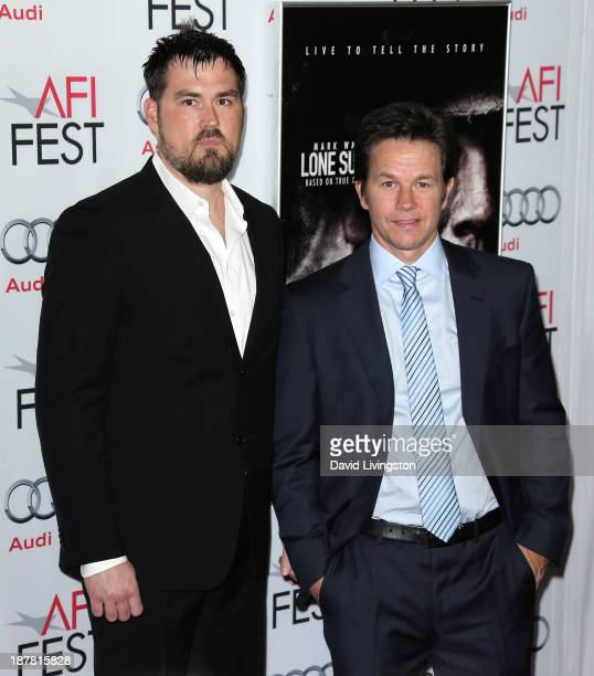 Retired Petty Officer 1st Class Navy SEAL Marcus Luttrell and actor Mark Wahlberg attend the AFI FEST 2013 presented by Audi premiere of Lone...