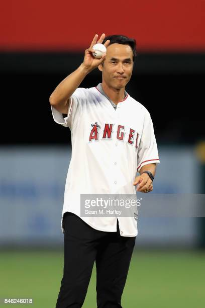Retired pitcher Shigetoshi Hasegawa of Japan throws out the ceremonial first pitch prior to a game between the Los Angeles Angels of Anaheim and the...