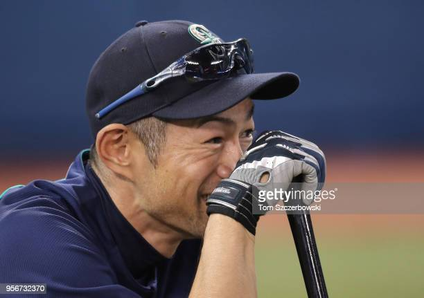 Retired player Ichiro Suzuki of the Seattle Mariners laughs during batting practice before the start of MLB game action against the Toronto Blue Jays...