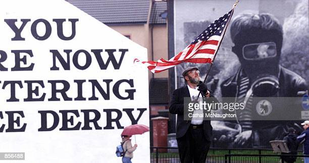 Retired police chief Jerry O''Keefe from Anaheim California holds an American flag February 3 2002 during a march to mark the 30th anniversary of the...