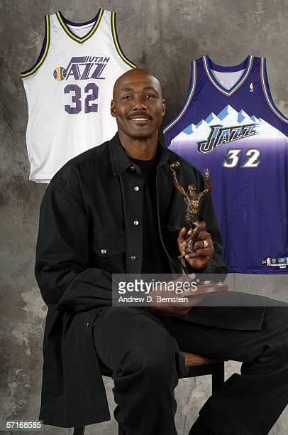 Retired power forward Karl Malone poses after the unveiling his statue commissioned by Utah Jazz owner Larry H Miller on March 23 2006 at the Delta...
