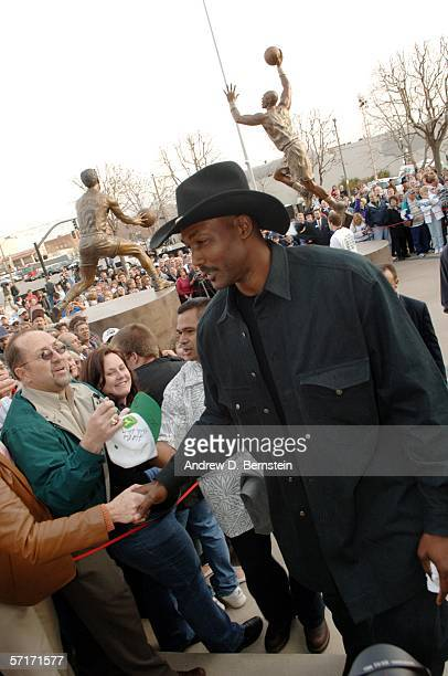 Retired power forward Karl Malone shakes hands after the unveiling his statue commissioned by Utah Jazz owner Larry H. Miller on March 23, 2006 at...