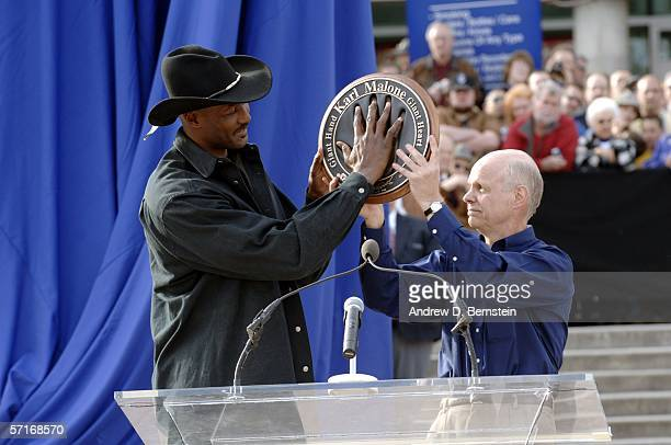 Retired power forward Karl Malone speaks at the unveiling his statue commissioned by Utah Jazz owner Larry H. Miller on March 23, 2006 at the Delta...