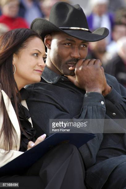 Retired power-foward Karl Malone listens at the unveiling of the statue commissioned by the Utah Jazz owner Larry H. Miller on March 23, 2006 at the...