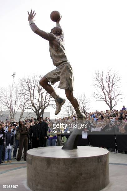 Retired powerfoward Karl Malone looks at the statue commissioned by the Utah Jazz owner Larry H Miller on March 23 2006 at the Delta Center in Salt...