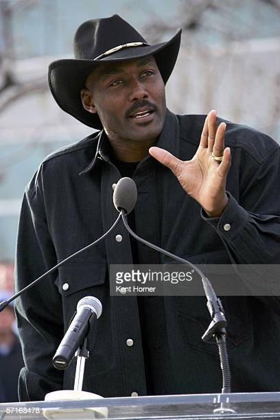 Retired power-foward Karl Malone speaks at the unveiling of the statue commissioned by the Utah Jazz owner Larry H. Miller on March 23, 2006 at the...